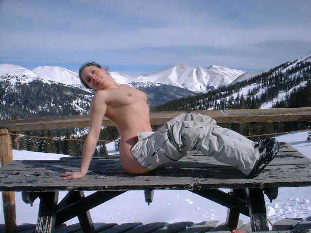 topless snowboarder